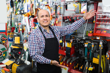 salesman showing different tools