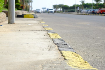 black and yellow lines on old asphalt, road surface