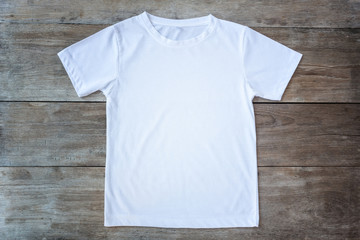 Top view of color T-Shirt on grey wood plank Wall mural