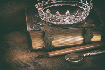low key image of diamond queen crown on old book