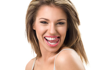 Attractive young woman with toothy smile