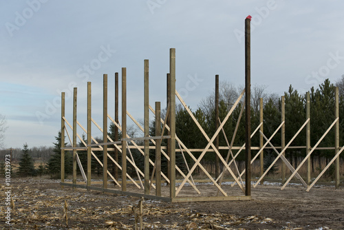 A pole barn under construction stock photo and royalty for How to build a pole shed step by step