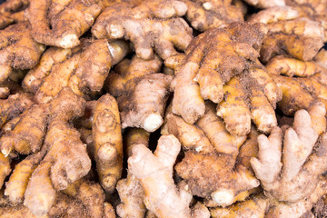 Large pile of fresh root ginger for sale at market