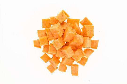 Fresh sweet potato cut into cubes , isolated on white background
