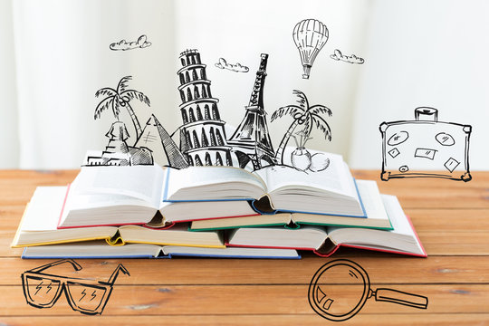 close up of books on table with landmarks doodles