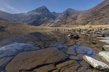 Poster Reflexion Carrauntoohil, the tallest peak in Ireland reflected in a calm lake,