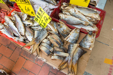 A selection of dry and cut fish outside at market