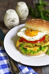 Vegetarian burger with guacamole and roasted egg.