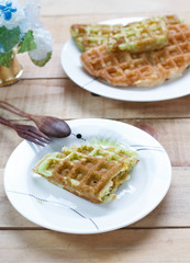 Corn vanilla and pandan  thai waffle on white dish , selection f