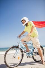 Senior superhero riding bike