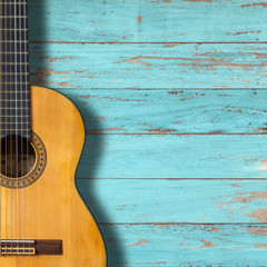 Cassical guitar on vintage wood background with copy space.