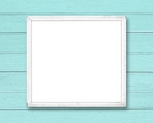 White blank old picture frame on blue wood wall.