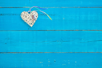 Blank teal blue sign and heart with rainbow ribbon