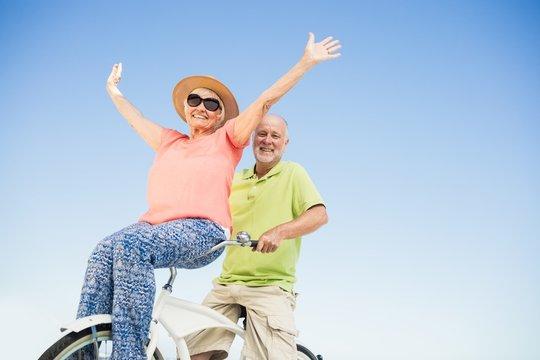 Senior couple going for a bike ride