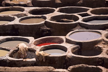 Morocco. Fez (Fes el-Bali). The tanner's quarter - close up of tubs (bend) with dyes in them