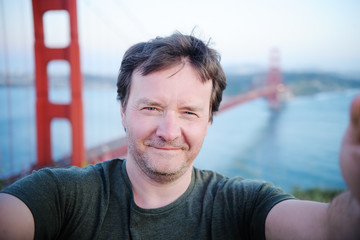 Man making a selfie with famous Golden Gate bridge