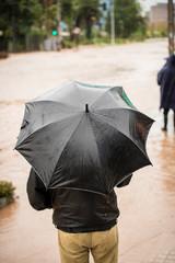 Man holding an umbrella during a flood at Santiago de Chile