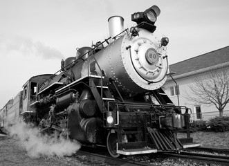An antique steam train photographed in black and white