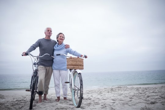 Happy senior couple with their bike