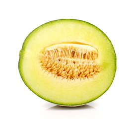 Melon cut half on white background.