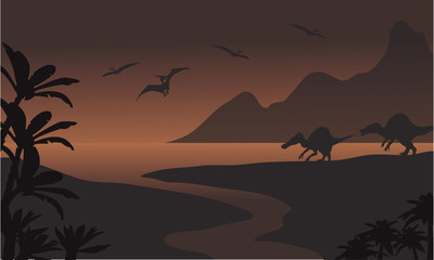 Silhouette of spinosaurus in riverbank and pterodactyl