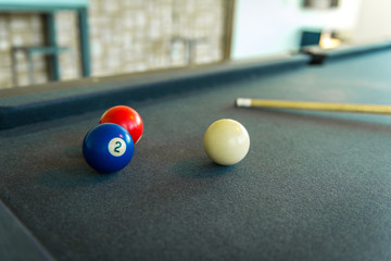 Closeup of billiard balls - red, blue and white.