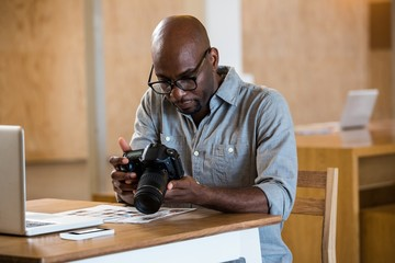 Man checking photo in camera