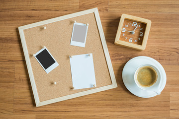 space board and some prop like coffee and clock giving business concept