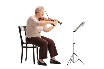 Mature female violinist playing a violin