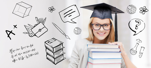 happy student woman in mortarboard with books