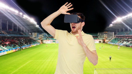 man in virtual reality headset over football field