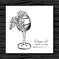 Glass of red wine with grapes. Sketch.  Grapevine.