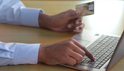Businessman online shopping with credit card and laptop computer