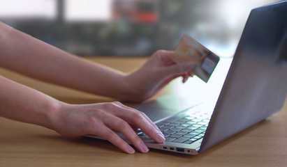 Businesswomen online shopping with credit card and laptop computer