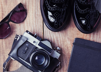 Shoes, vintage camera, notepad and sunglasses