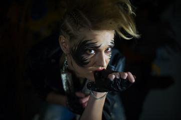 Beautiful punk girl  posing in street