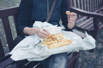 Woman eating fish and chips
