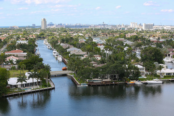 Aerial view of Fort Lauderdale's Intracoastal waterway canals, residential homes and skyline.