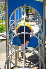 Little boy at playground plays sports. Fitness motivation
