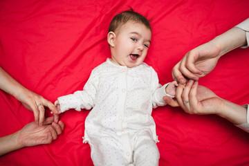 baby and paarents hands
