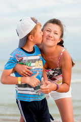 the boy with his mother on the beach