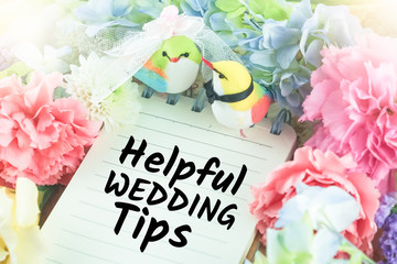 selective focus at word helpful wedding tips on notepaper wedding bird and flower background