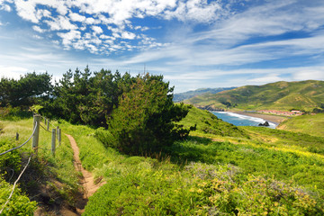Green meadows and view of the Pacific Ocean at Point Bonita, California
