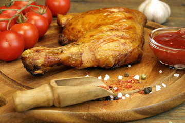 Barbecued Chicken Quarter On The Wood Cutting Board