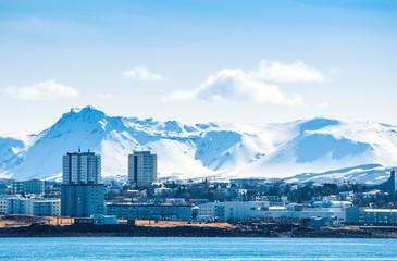 Reykjavik city in Ieland beneath a mountain