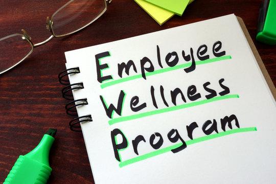 Employee Wellness program written on a notepad with marker.