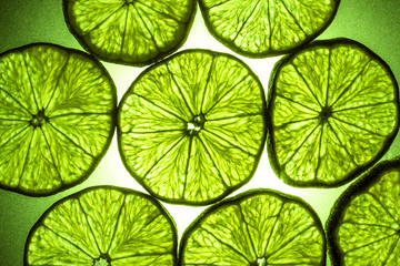 Macro shot of a slice of lime in transmitted light
