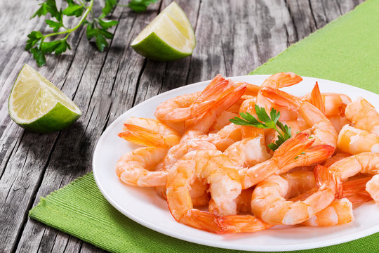 boiled tails of king shrimps on a white dish