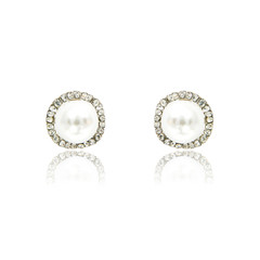 Pair of diamond and natural pearls earrings isolated on white