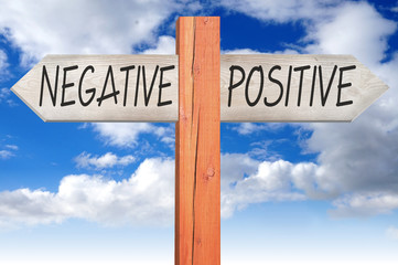 Negative or positive - wooden signpost